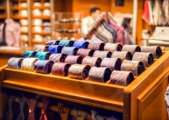 Assortment of man's tie of shop's shelf at luxury business outfit store.